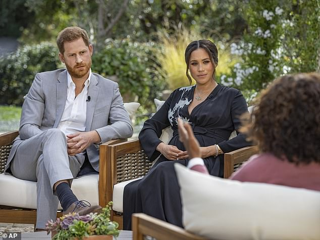 'When you look at what happened with Meghan, you realise how easy it is to marry into that family and get it completely wrong,' adds Gary Goldsmith. He gives a little laugh as he refers to 'our Kate' (by contrast, the Duchess of Sussex and her husband are 'those muppets'). Above, Harry and Meghan during their Oprah interview