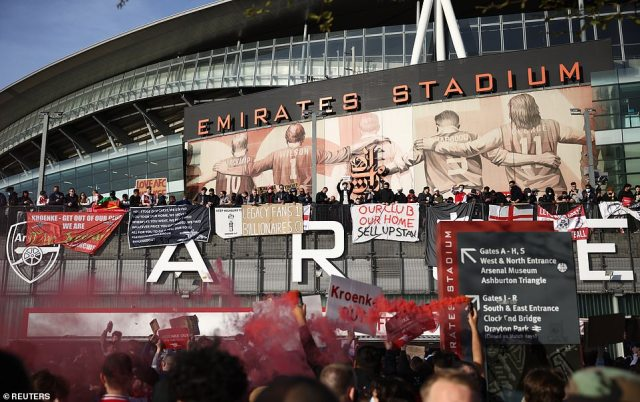 The hundreds of Gunners fans hung banners over the edge of the concourse including ones that read, 'Arsenal till I die. Kroenke out,' and 'Our club our home. Sell up Stan.' Stan Kroke has been an unpopular owner for a long time