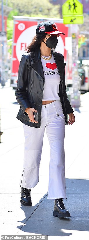 Something special: Bella rocked all white with a leather jacket and black boots as she picked out a gift for her sister