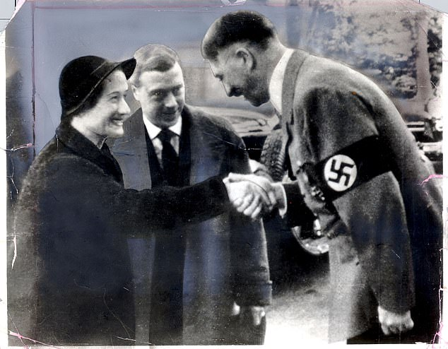 Hitler shaking hands with Duchess of Windsor in 1937,the Duke of Windsor in the backgroundEdward and Mrs Simpson