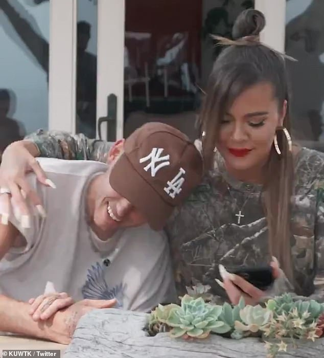 Exhausted: 'I feel just like exhausted,' Khloé added as she emotionally hugged a friend in one shot of the promo video