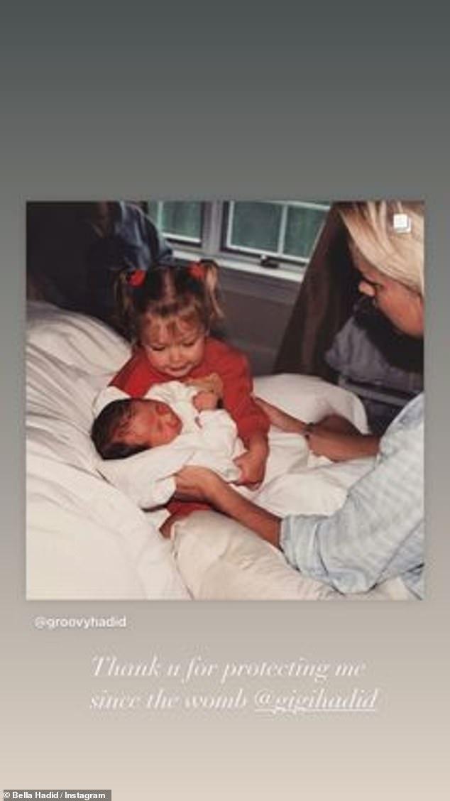 Too cute:In one image, baby Gigi was seen holding newborn Bella with mom Yolanda looking on