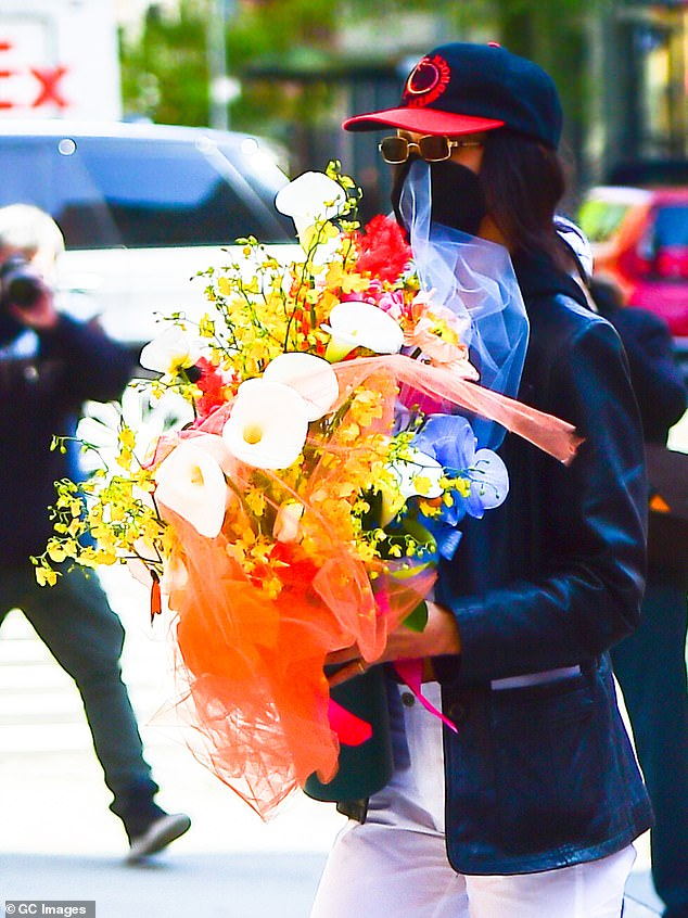 So sweet:Earlier in the day, Bella was seen heading over to Gigi's place with an enormous bouquet of flowers