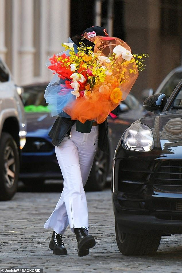 Thoughtful: Bella carried the bouquet in her arms on Friday morning in NYC
