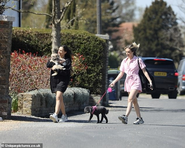 Walkies! Megan McKenna was seen taking her poodle Daisy for a stroll with a pal in Essex before heading for some lunch on Friday afternoon