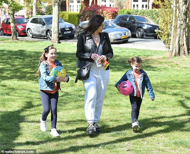 Low-key:The former Big Brother star, 38, cut a low-key figure as she enjoyed an outing with her two daughters Ariana, eight, and Siera, five