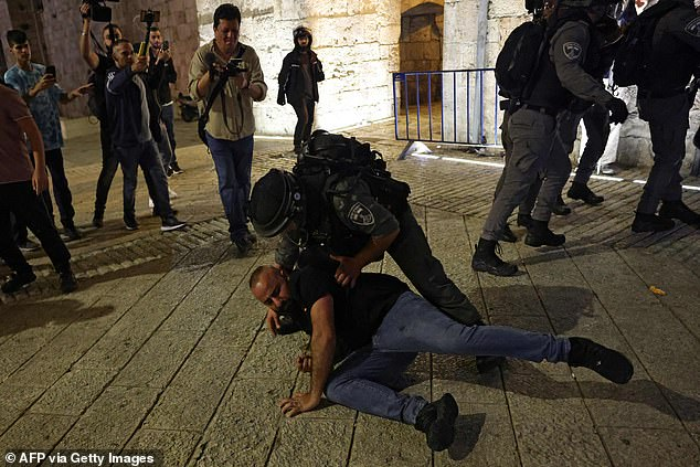 Pictured:Israeli security forces detain a Palestinian protester during clashes in Jerusalem's Old City on April 24, 2021