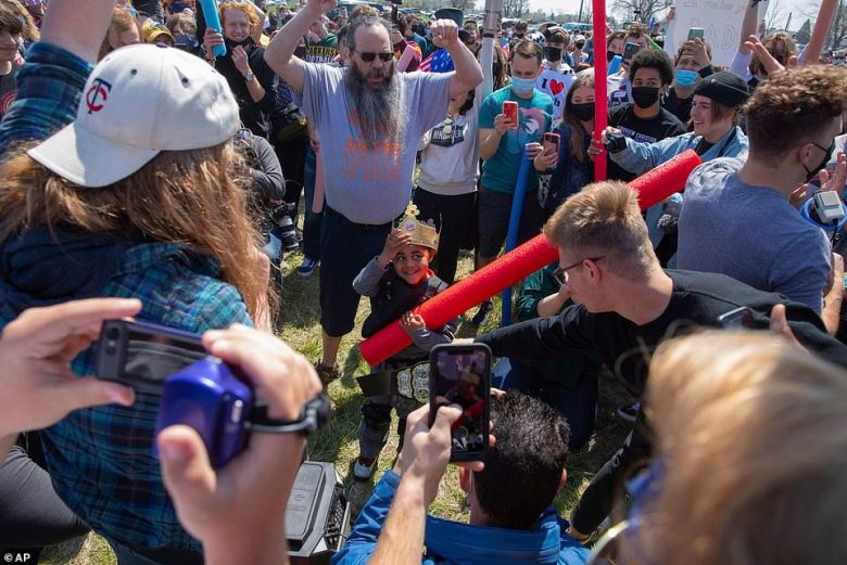 People gather around a little boy named Josh who was crowned the ultimate Josh on Saturday