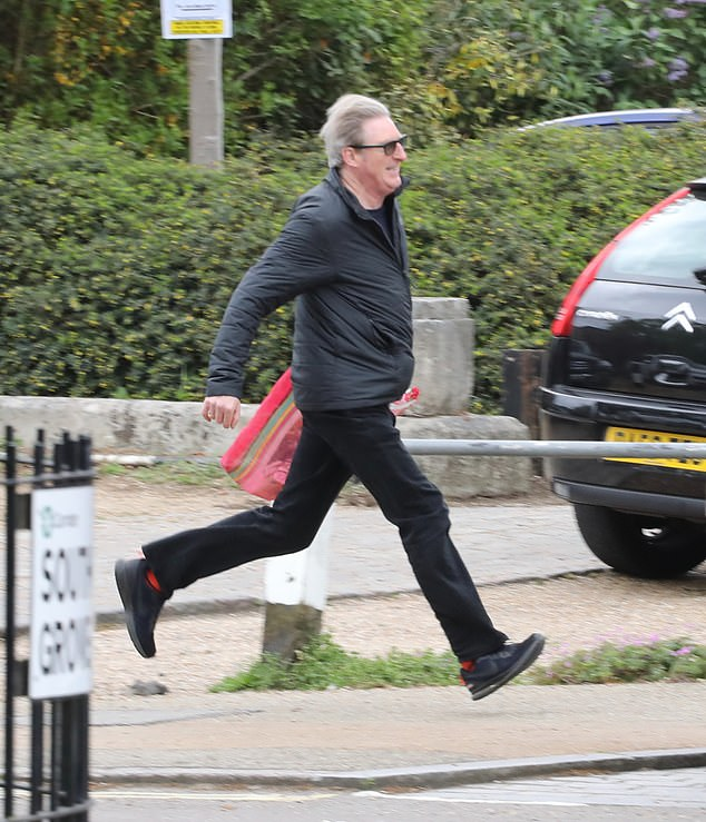 Speedy: Line Of Duty's Adrian Dunbar, who playsSuperintendent Hastings in the show, was spotted making a quick dash for the busin north London over the weekend