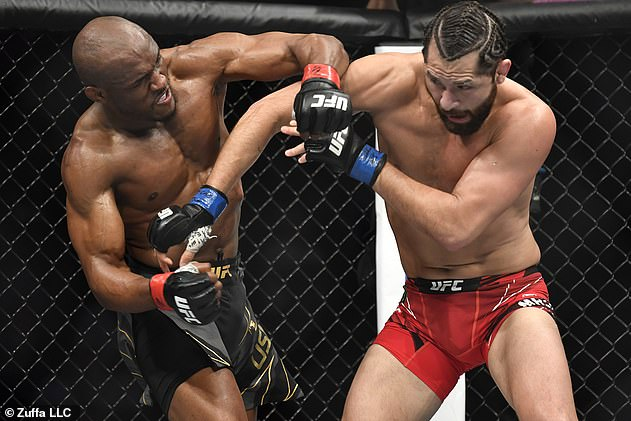 Usman (L) knocked Jorge Masvidal (R) out within two rounds at UFC 261 on Saturday night