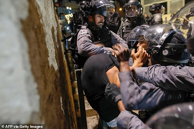 Israeli security forces detain a Palestinian protester on Saturday night