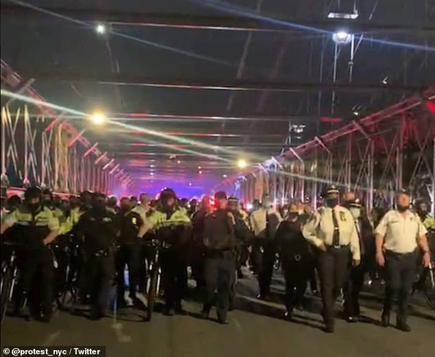 Dozens of Black Lives Matter protesters were seen clashing with officers of the New York Police Department on Saturday while marching across the Brooklyn Bridge