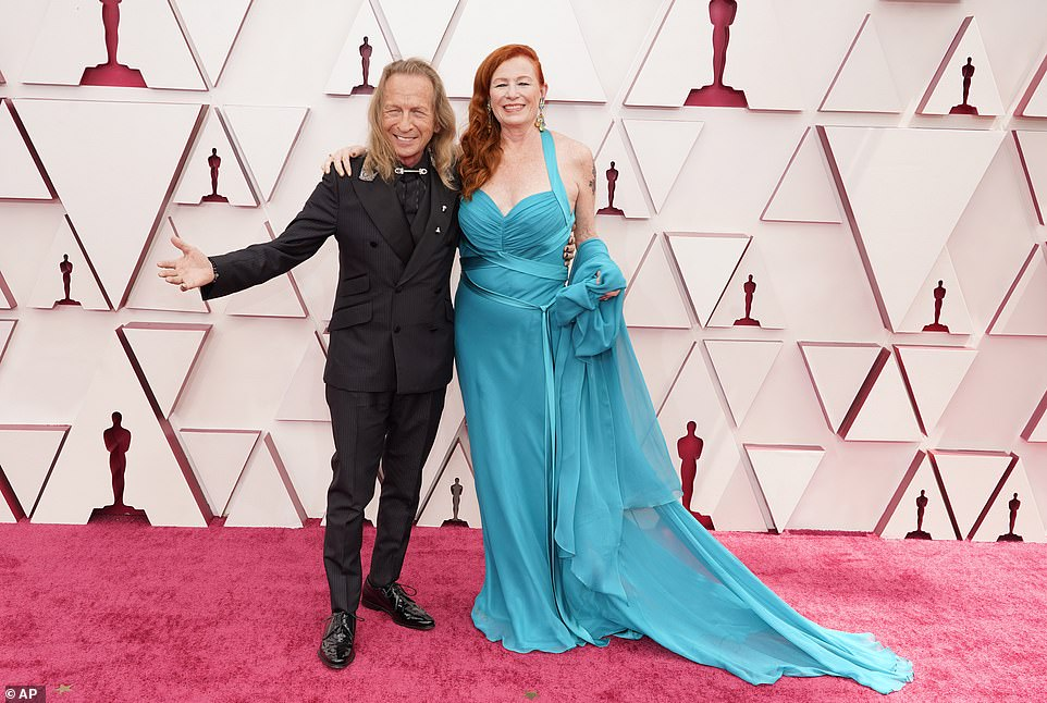 Ready to roll: Paul Raci, left, in a black suit and Liz Hanley Raci in a teal gown