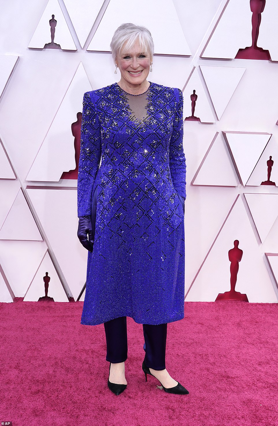 Chic: Glenn Close chose a sparkling midnight blue and black patterned tunic with black trousers and pointed classic heels, adding silky gloves. She is wearing Armani Prive; the custom look took three weeks to make
