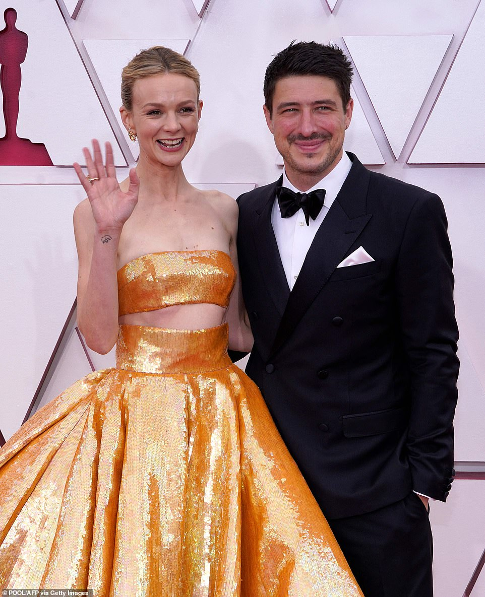 Couple:Carey, who has already scooped this years Best Actress BAFTA for her role, attended the prestigious event with her singer husband Marcus Mumford (pictured)
