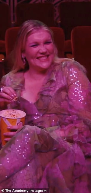 Full of laughter: Emerald happily ate popcorn and giggled away ahead of the ceremony