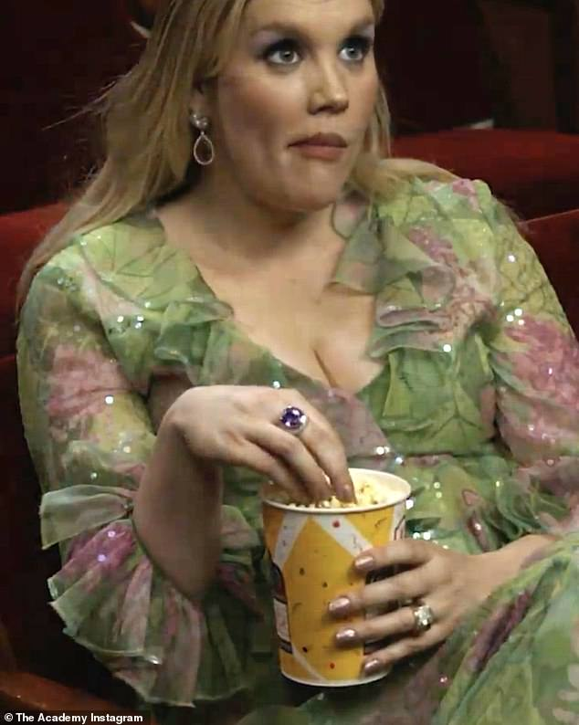 Snacking:The nominee was later seen enjoying a tub of hot tub as she filmed a humorous video for the Academy's official Instagram page in their Movie Palace