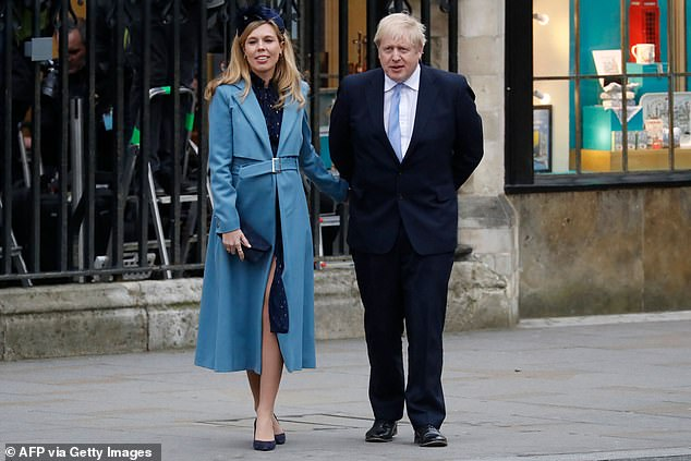 Britain's Prime Minister Boris Johnson (R) with his partner Carrie Symonds leave after attending the annual Commonwealth Service at Westminster Abbey