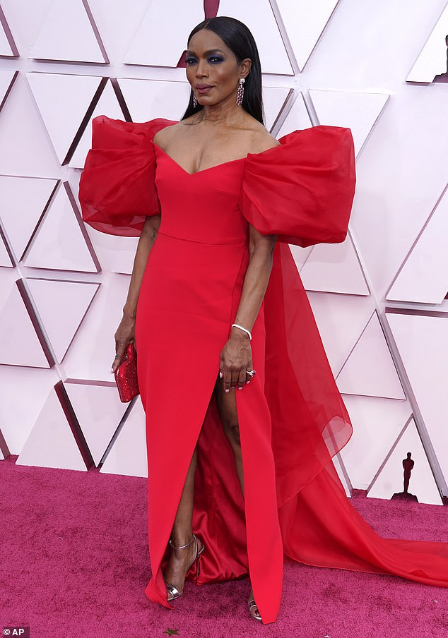 Chic:For the 93rd annual Academy Awards, Angela looked effortlessly chic in an elegant Alberta Ferretti gown in a striking crimson hue