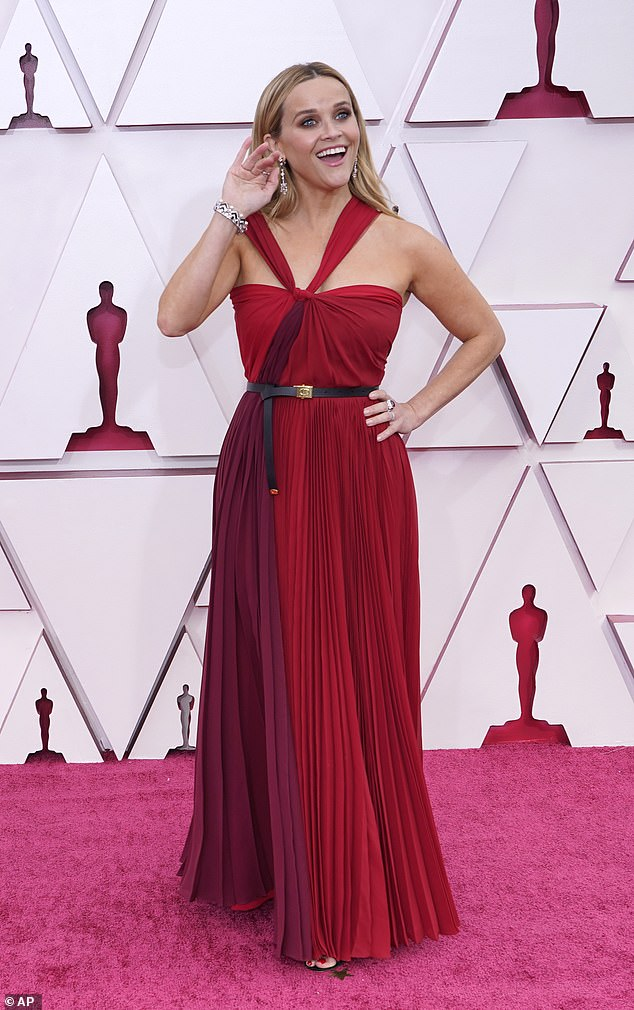 On Sunday: Witherspoon waved to onlookers at the 93rd annual Academy Awards in Los Angeles, in a stunning multi-shaded scarlet gown courtesy of Dior