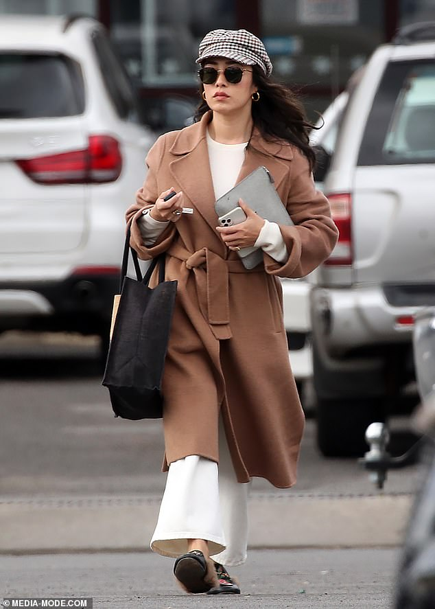 Dressed to impress:MasterChef's Melissa Leong (pictured) cut a stylish figure in an all-white ensemble and designer coat as she stepped out in Melbourne on Saturday
