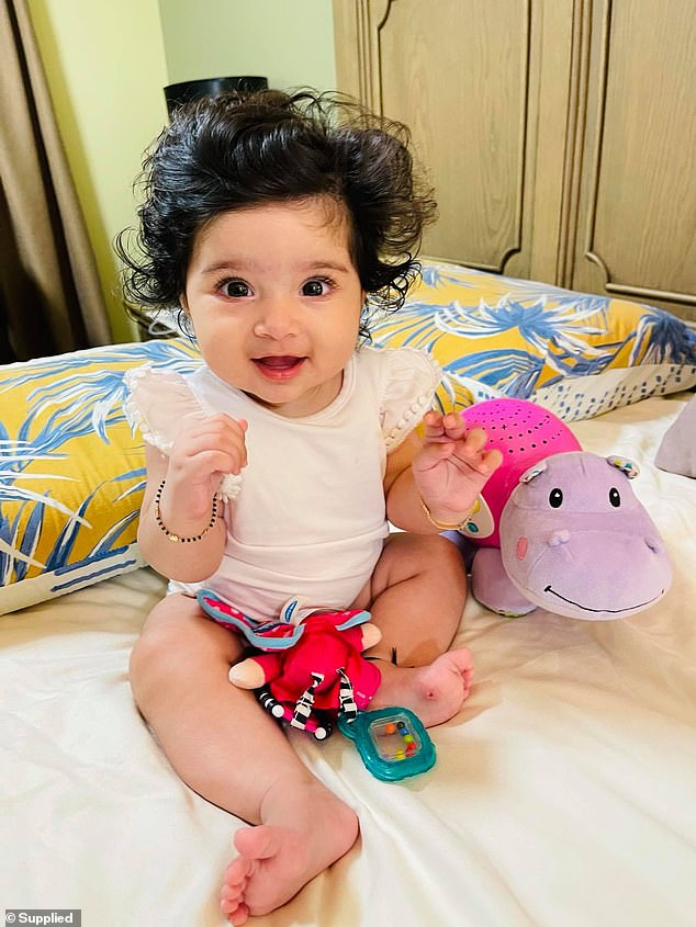 Nitya's hair never fell out and has continued to grow thick and long, she is pictured here at four months