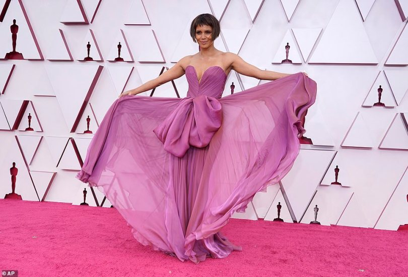 New haircut: Halle Berry sported a short haircut and a purple strapless gown with a large bow detail in the center and a sheer skirt
