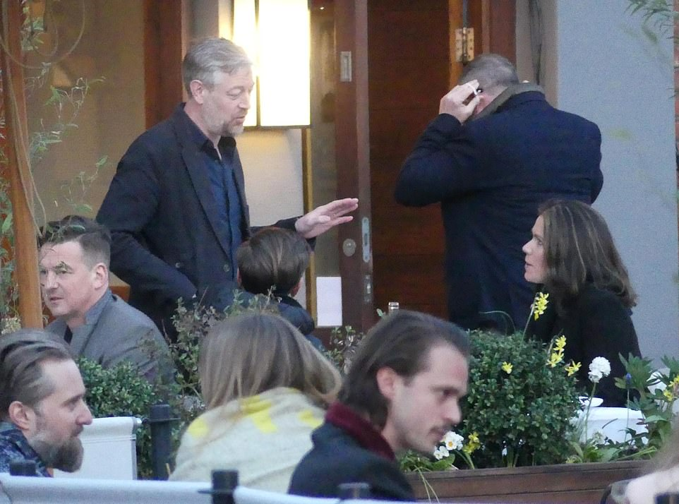 Chatting: The star was joined by her former beau for the meal, and they were seen briefly chatting to a pal they'd spotted in the eatery