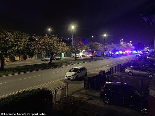 Three people have died in a crash after a BMW smashed into a roundabout near to a pub this morning. Pictured: Police at the scene