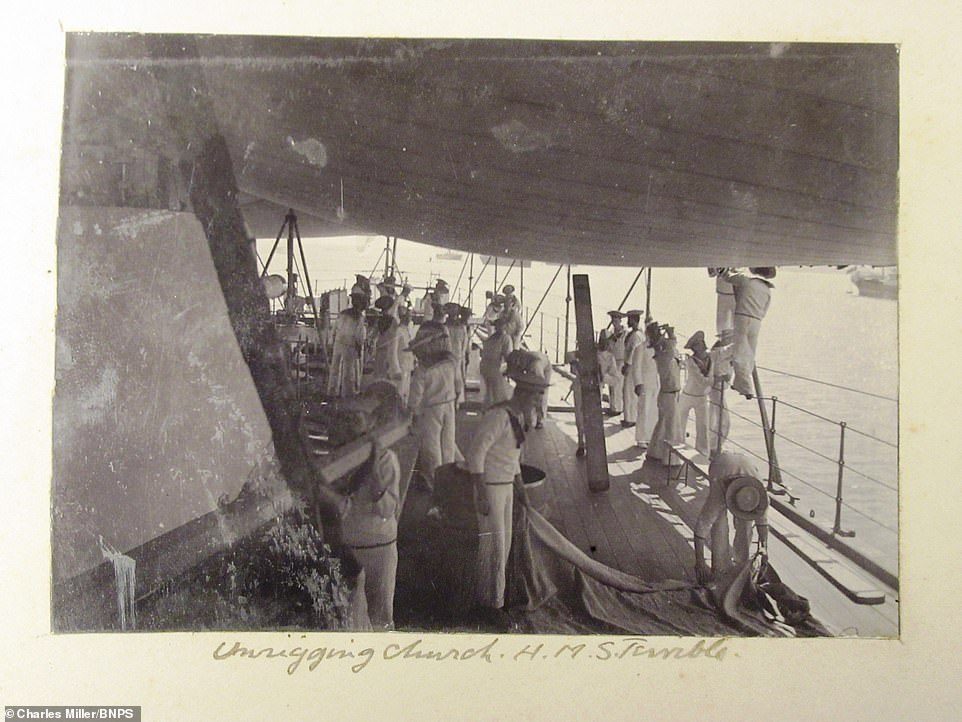 Dorling took this image on HMS Terrible whilst crew members were removing an awning following a church service on the vessel. He wrote in the caption: 'Unrigging church'