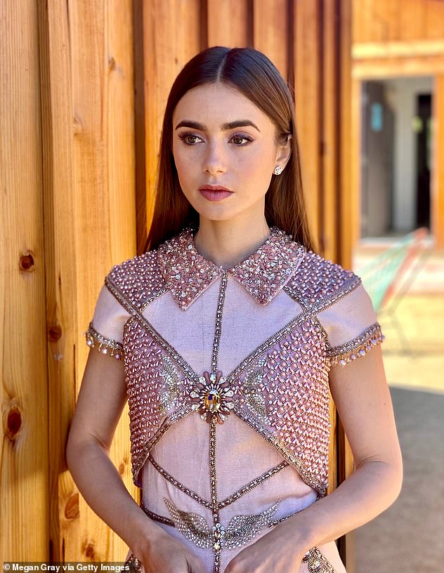 Wow:The actress slipped into a magical jewel-encrusted dress for the prestigious event, and looked at ease in front of the lens