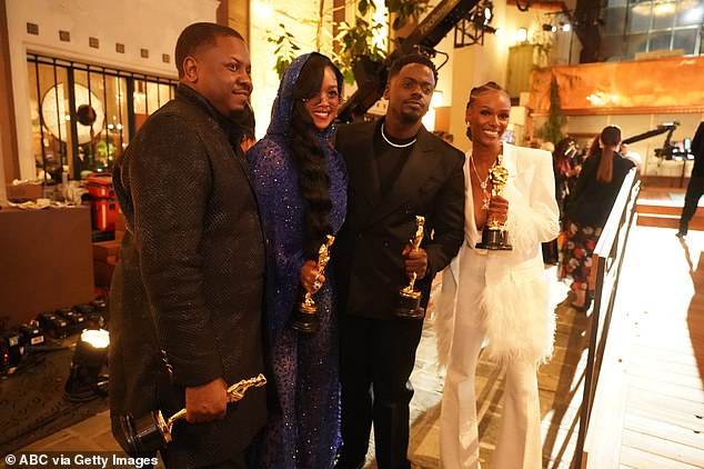 Actor Daniel Kaluuya, who won best supporting actor for Judas and the Black Messiah, poses alongside musicians Dernst Emile II, H.E.R., and Tiara Thomas who won the Oscar for best original song which featured in the film