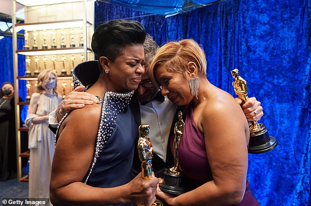 Mia Neal, Sergio Lopez-Rivera, and Jamika Wilson, winners of the Makeup and Hairstyling award for Ma Rainey's Black Bottom share a moment of emotion backstage at the Oscars