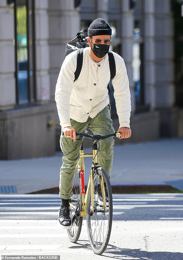 On Monday: Justin Theroux was seen riding along on his shiny golden bicycle through the streets of New York City
