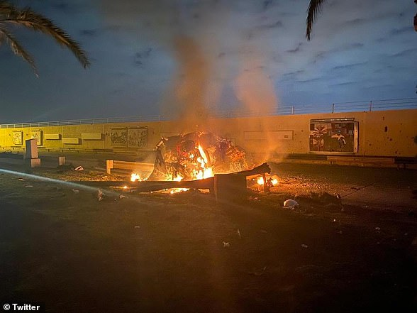 The burning wreckage of a car believed to have been carrying General Soleimani at Baghdad airport after being hit by a US drone