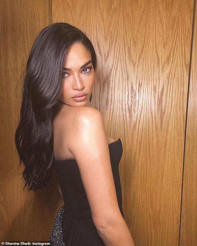 Letting her dress do the talking!Shanina left her decolletage bare, but accessorised with some diamond drop earrings