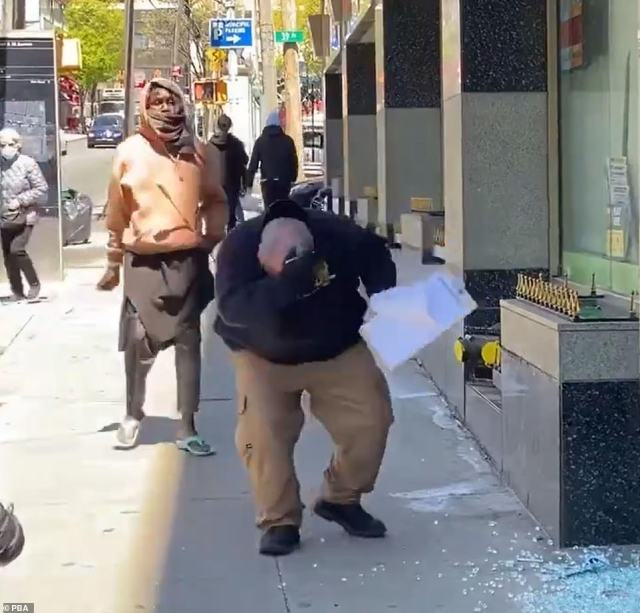 The officer, working in Queens, recoils in pain and Morgan looks on, before running away and being arrested