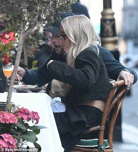 Quality time: The pair looked in sync as they ate lunch together before staring into one another's eyes