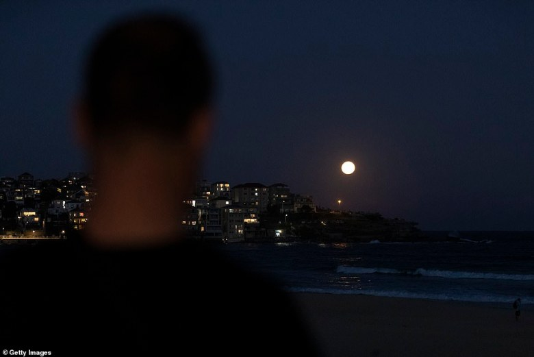The natural wonder drew crowds as many stopped to watch the captivating sight as it hung in the sky over Bondi Beach