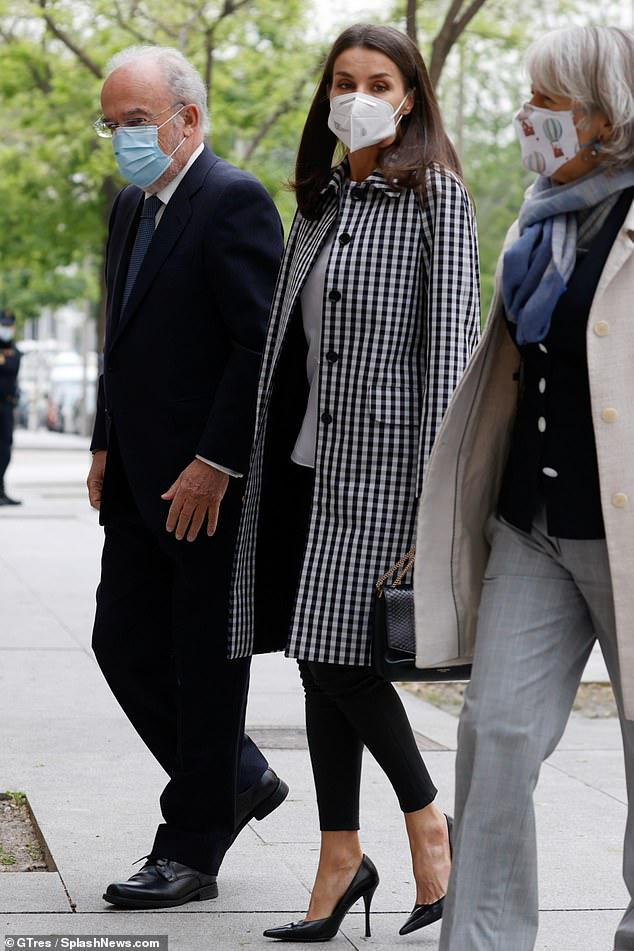 The mother-of-two, 48, looked effortlessly chic when arriving at the Royal Academy of the Language in Madrid (pictured)