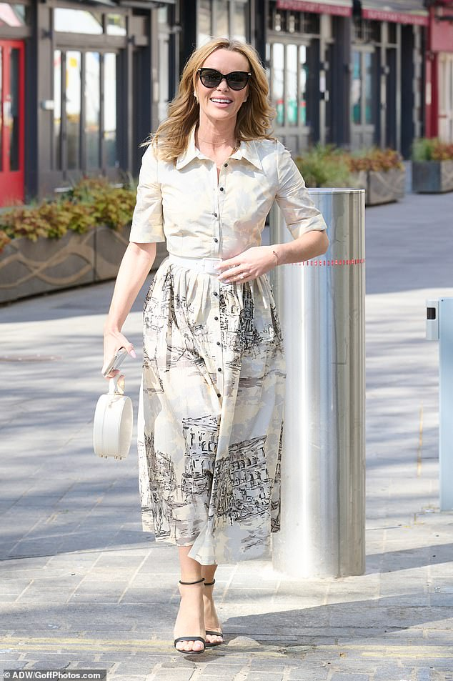 Commanding attention: Amanda Holden caught the eye as she left London's Global Studios after her Heart Breakfast show on Tuesday