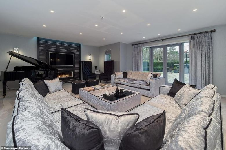 The former England international put the pad on the market in late February but it is already listed as 'sold subject to terms and conditions' on Rightmove (living room pictured)