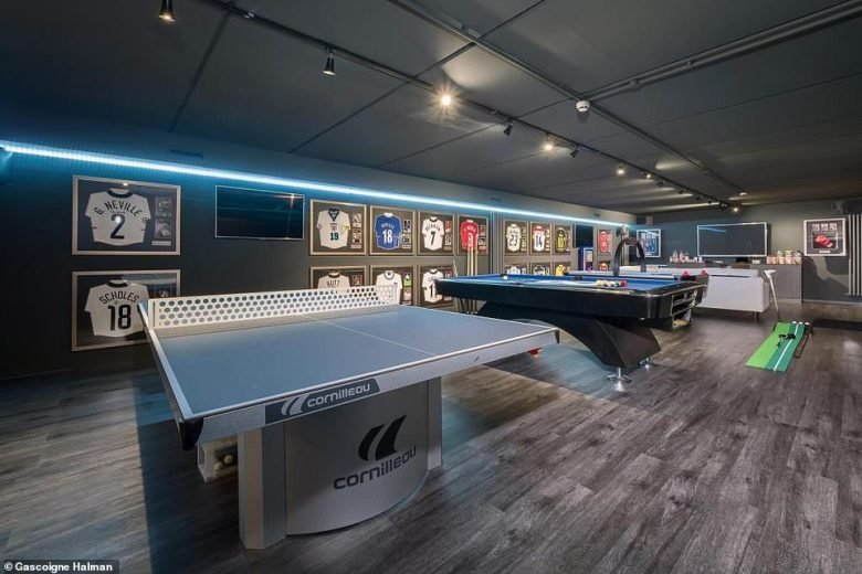 Former footballer Neville, 44, has also enjoyed the use of a pool, cinema and games room (pictured) complete with a table tennis and pool table