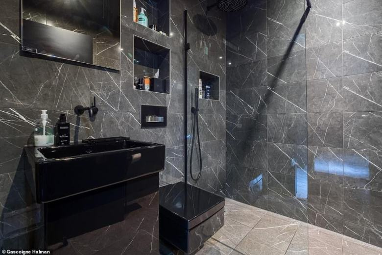 The property also boasts six bathrooms to match the bedrooms as well as six separate shower lounges (monochrome showroom pictured)