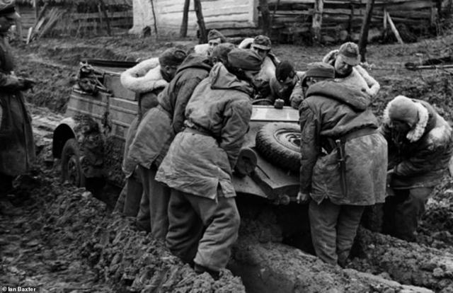 German troops are seen pushing pulling a utility car through the mud. The Soviet Union's Operation Bagration offensive, carried out in July 1944, led to a succession of German collapses on the Eastern Front. By August, the Red Army had reached Poland
