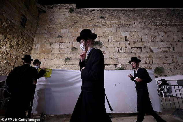 Ultra Orthodox Jews pictured at the Western Wall in the old city of Jerusalem, on September 18, 2020.A Jerusalem ultra-Orthodox rabbi has been accused of being an undercover Christian missionary