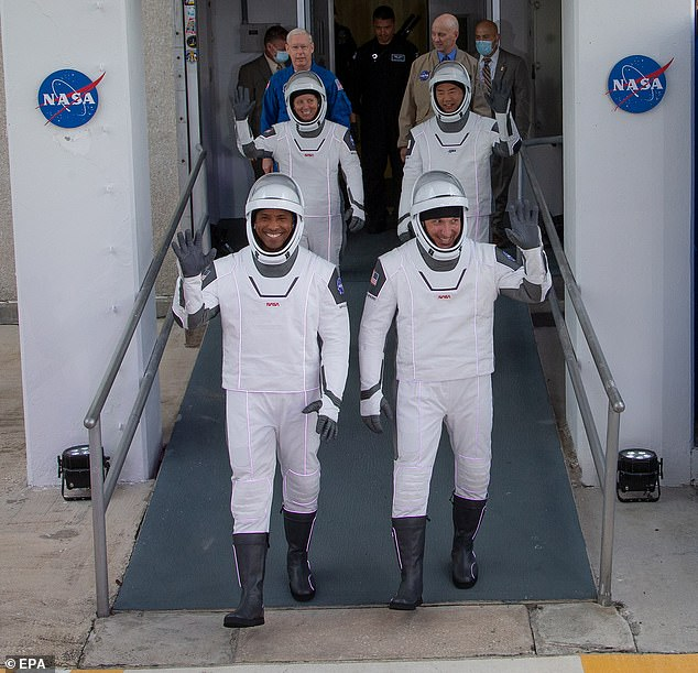 The crew led by Hopkins (front right), an Air Force colonel, includes physicist Walker (back left) and rookie astronaut Glover (front left), who is the first black astronaut to spend an extended amount of time on the space station. Noguchi (front right) also became only the third person to rocket into orbit aboard three different kinds of spacecraft.
