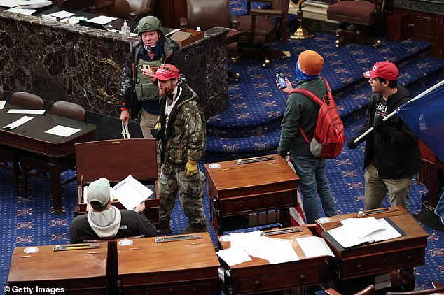 Rioters inside the Senate Chamber on January 6, minutes after it was cleared of lawmakers. Carville says Democrats need to relentlessly tie the insurrection to Republicans