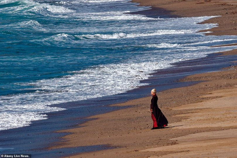 Stunning scenery:During the shoot, the two actors were seen talking on the golden sands and walking along the beach before Emma headed towards the water