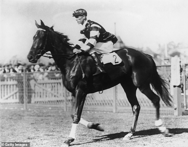 Pictured:Australian race horse Phar Lap, regarded by many as the greatest race horse ever, ridden by jockey Jim Pike at the AJC Derby in Randwick on October 5, 1929